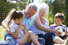 Grandparents And Grandchildren Playing Football In Garden Royalty Free Stock Photo