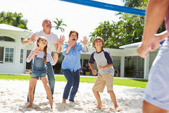 Grandparents And Grandchildren Playing Volleyball In Garden Royalty Free Stock Images