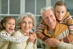 Grandparents with grandchildren portrait stock photos