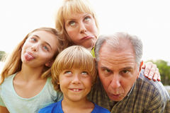 Grandparents And Grandchildren Pulling Funny Faces stock photography