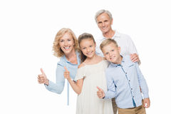 Grandparents and grandchildren showing thumbs up royalty free stock photography