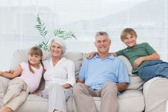 Grandparents and grandchildren sitting on couch Royalty Free Stock Image