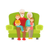 Grandparents And Grandchildren Sitting On The Sofa, Part Of Grandparent  Grandchild Passing Time Together Set Royalty Free Stock Images