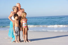 Grandparents And Grandchildren Standing On Beach. Grandparents And Grandchildren Standing On Sandy Beach Royalty Free Stock Photos