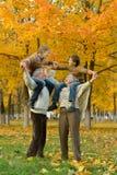 Grandparents and grandchildren. Together in autumn park stock image
