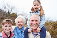 Grandparents With Grandchildren On Walk In Countryside stock photography