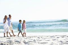 Grandparents and Grandchildren Walking Along Beach Stock Photo