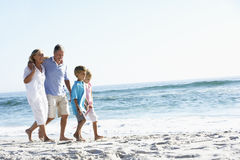 Grandparents and Grandchildren Walking Along Beach Royalty Free Stock Images