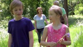 Grandparents And Grandchildren Walking Along Woodland Path stock footage
