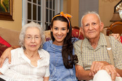 Grandparents and Granddaughter Stock Images