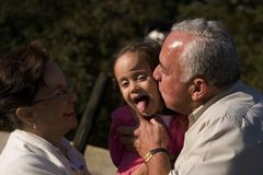 Grandparents and granddaughter Stock Photography