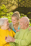 Grandparents with granddaughter Stock Photography