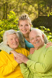 Grandparents with granddaughter Stock Photo