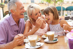 Grandparents With Granddaughter In Cafe Stock Image