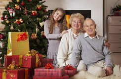 Grandparents and granddaughter celebrating Christmas Stock Images