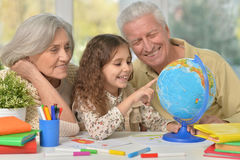Grandparents with granddaughter drawing Stock Images