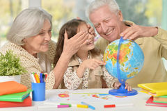 Grandparents with granddaughter drawing Stock Image