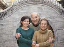 Grandparents and granddaughter in front of round arch, Beijing Royalty Free Stock Image