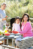 Grandparents And Granddaughter Having Outdoor Barbeque Royalty Free Stock Photography
