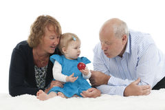 Grandparents with granddaughter, isolated on white Royalty Free Stock Photos