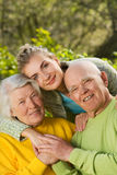 Grandparents with granddaughter outdoors Royalty Free Stock Images