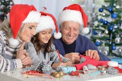 Grandparents and granddaughter preparing for Christmas Royalty Free Stock Photo