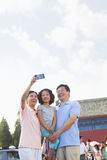 Grandparents and granddaughter taking self portrait with Cell Phone Stock Photo