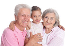 Grandparents with granddaughter on white. Happy grandparents with granddaughter on white background Stock Photos