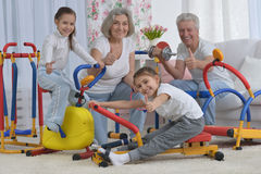 Grandparents  and  granddaughters doing exercise Stock Images