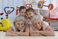 Grandparents  and  granddaughters doing exercise Stock Photo