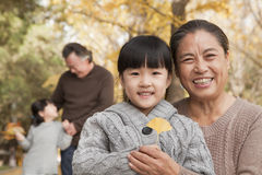 Grandparents and granddaughters in park Stock Photos