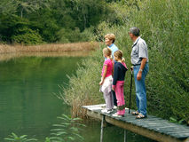 Grandparents and granddaughters on river Royalty Free Stock Photos
