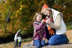 Grandparents and grandkids exploring in woods Royalty Free Stock Photos