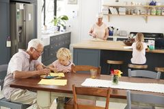Grandparents and grandkids in family kitchen, elevated view stock photo