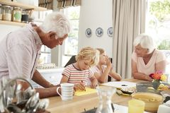 Grandparents and grandkids talking in the kitchen, close up stock photo