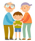 Grandparents and grandson. Happy grandparents standing with their grandson Royalty Free Stock Photos