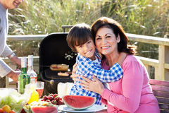 Grandparents And Grandson Having Outdoor Barbeque Stock Image