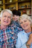 Grandparents with grandson at home Stock Image