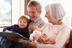 Grandparents With Grandson And Newborn Baby Granddaughter Royalty Free Stock Photography