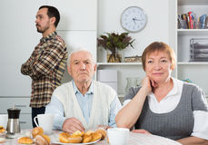 Grandparents and grandson of  offense Stock Photography
