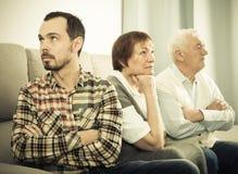 Grandparents and grandson serious talk Stock Photos
