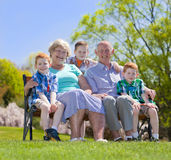 Grandparents. Happy grandparents with their grandson sitting outside Royalty Free Stock Photos