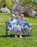 Grandparents. Happy grandparents with their grandson sitting outside Stock Photo
