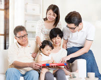 Grandparents having fun with offsprings. Asian multi generations having fun at home. Happy family portrait Royalty Free Stock Photos