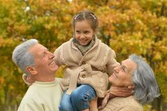 Grandparents with her granddaughter Royalty Free Stock Photos