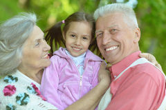 Grandparents with her granddaughter Stock Images