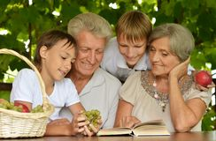 Grandparents with her grandson Stock Image