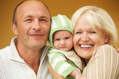 Grandparents with his grandchild Stock Photography