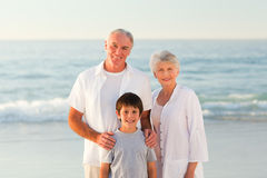 Grandparents with his grandson at the beach Stock Images