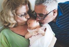 Grandparents Holding Sleeping Newborn Baby Granddaughter royalty free stock photo